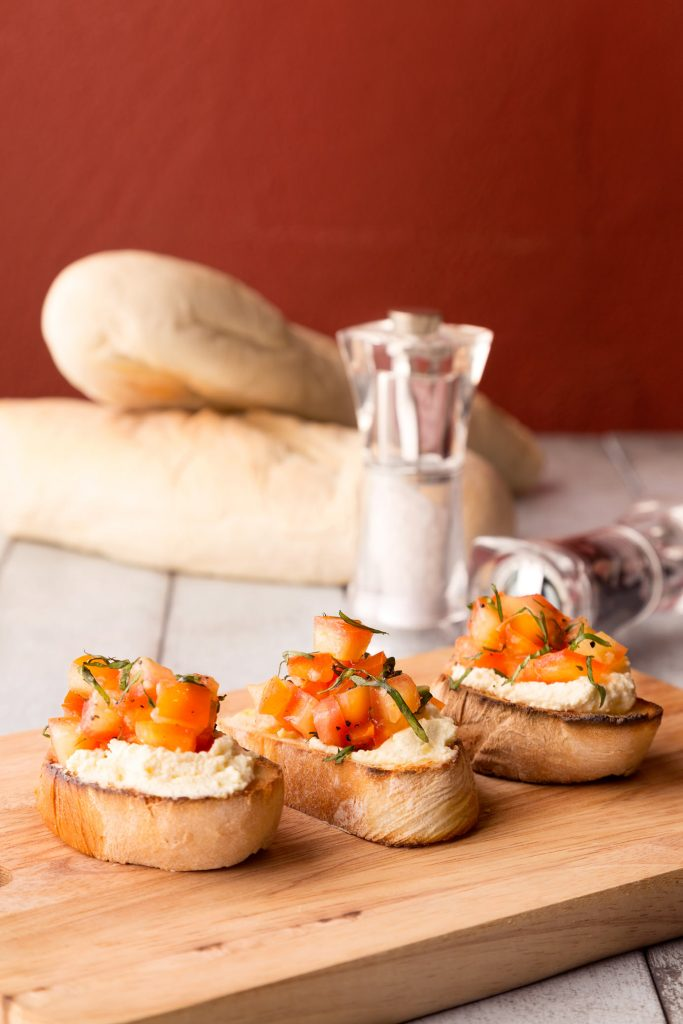 Food image of bruschetta for Luccas Trattoria Italian Dining. Food photography by award winning food photographer Fauzi Anuar for Zee and Marina Photography.